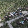 In this photo released by the Philippine Army 10th Infantry Division shows an aerial view of toppled trees and homes caused by flashfloods in Compostela Valley province, southern Philippines on Thursday Dec. 6, 2012. The powerful typhoon that washed away emergency shelters, a military camp and possibly entire families in the southern Philippines has killed hundreds of people with nearly 400 missing, authorities said Thursday. (AP Photo/ Philippine Army 10th ID)