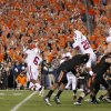 Oklahoma State kicker Quinn Sharp (13) kicks the game winning field goal as teammate Wes Harlan (11) holds against Stanford during overtime of the Fiesta Bowl NCAA college football game Monday, Jan. 2, 2012, in Glendale, Ariz. Oklahoma State won 41-38. (AP Photo/Matt York) ORG XMIT: PNP157