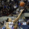Connecticut\'s Kiah Stokes (41) drives over SMU\'s Akil Simpson (5)during the first half of an NCAA college basketball game in Storrs, Conn., Tuesday, Feb. 4, 2014. (AP Photo/Fred Beckham)