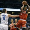 Milwaukee Bucks\' Marquis Daniels (6) looks to pass the ball as he is guarded by Orlando Magic\'s Nikola Vucevic (9), of Montenegro, during the first half of an NBA basketball game, Wednesday, April 10, 2013, in Orlando, Fla. (AP Photo/John Raoux)