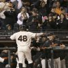 San Francisco Giants\' Pablo Sandoval (48) is congratulated by manager Bruce Bochy, right, after scoring on Tony Abreu\'s three-run triple against the Los Angeles Dodgers during the second inning of a baseball game in San Francisco, Wednesday, Sept. 25, 2013. (AP Photo/Jeff Chiu)