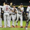 Photo -   St. Louis Cardinals players celebrate their 6-1 win over the Houston Astros in a baseball game, Monday, Sept. 24, 2012, in Houston. (AP Photo/Pat Sullivan)