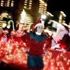 Chelsea Agee of Edmond walks beside a float for X-Treme Cheer and Dance during the Parade of Lights in Edmond, Okla., Dec. 1, 2004. By Bryan Terry/The Oklahoman