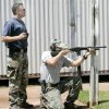 Edmond police officer Bryan Weathers coaches as officer Jason Stearns practices for the upcoming finals of the 5.11 Challenge shooting competition at the police training facility in Edmond, August 22, 2007. Stearns is shooting a pump action patrol rifle. By Steve Gooch, The Oklahoman.
