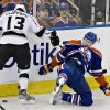 Los Angeles Kings\' Kyle Clifford, left, checks Edmonton Oilers\' Jeff Petry during second period NHL hockey action in Edmonton, Alberta, on Tuesday Feb. 19, 2013. (AP Photo/THE CANADIAN PRESS,Jason Franson)