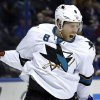 Photo - San Jose Sharks' Joe Pavelski celebrates after scoring during the first period of an NHL hockey game against the St. Louis Blues on Tuesday, Dec. 17, 2013, in St. Louis. (AP Photo/Jeff Roberson)