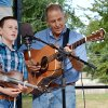 Photo -  Lane Gore, 12, left, and his father, Gary Gore, perform during the Blanchard Bluegrass Festival. Photo by M. Tim Blake, for The Oklahoman   M. Tim Blake