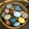 This undated image courtesy of Amy Gates shows a basket full of eggs dyed by Gates, of Longmont, Colo., which appears on her blog, Crunchy Domestic Goddess. Gates dyes her eggs with foods and spices. It\'s healthier, she maintains, and fun, like a science project. (AP Photo/Amy Gates)