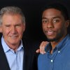 Photo - In this Saturday, March 23, 2013 photo, Harrison Ford. left, and Chadwick Boseman, cast members in the film