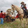 Wagon master Jim Gaines of Bowlegs talks with Ruth Baird of Meeker as she waters mules in Slaughterville, Oklahoma on Thursday, April 17, 2008. This is the last stop for the wagon train before continuing on to Norman for the 89er day parade. BY STEVE SISNEY, THE OKLAHOMAN