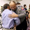 Photo - Grady County Sheriff's Deputy Roy Spratt (right) hugs Pastor David Rivers following the Surthrivor Service (CQ) SURTHRIVOR at Ridgecrest Baptist Church in Bridge Creek Oklahoma on May 3, 2009. Photo by John Clanton ORG XMIT: KOD