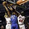 Chicago Bulls\' Taj Gibson (22) and Nazr Mohammed (48) put defensive pressure on Orlando Magic\'s Gustavo Avon during an NBA basketball game in Chicago on Tuesday, Nov. 6, 2012.(AP Photo/Charles Cherney)