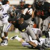 OSU\'s Joseph Randle (1) breaks away from the Kansas State defense for OSU\'s final touchdown in the fourth quarter during a college football game between the Oklahoma State University Cowboys (OSU) and the Kansas State University Wildcats (KSU) at Boone Pickens Stadium in Stillwater, Okla., Saturday, Nov. 5, 2011. OSU won, 52-45. Photo by Nate Billings, The Oklahoman