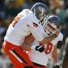 Oklahoma State\'s J.W. Walsh (4) celebrates a touchdown with Daniel Koenig (58) in the fourth quarter during a college football game between the Oklahoma State University Cowboys (OSU) and the Baylor University Bears at Floyd Casey Stadium in Waco, Texas, Saturday, Dec. 1, 2012. Photo by Nate Billings, The Oklahoman