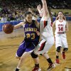 FORT GIBSON / CLASS 4A GIRLS HIGH SCHOOL BASKETBALL / STATE TOURNAMENT: Anadarko\'s Lakota Beatty (23) drives past Ft. Gibson\'s Brooke Palmer (24) during the 4A girl State Basketball Championship game between Ft. Gibson High School and Anadarko High School at State Fair Arena on Saturday, March 10, 2012 in Oklahoma City, Okla. Photo by Chris Landsberger, The Oklahoman