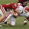 Cameron Kenney (6) is brought down by Jaydan Bird (55) during the spring Red and White football game for the University of Oklahoma (OU) Sooners at Gaylord Family/Oklahoma Memorial Stadium on Saturday, April 17, 2010, in Norman, Okla. Photo by Steve Sisney, The Oklahoman