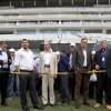Photo - Brazil's former soccer player Ronaldo, second from left, Brazil's Sports Minister Aldo Rebelo, center, FIFA Secretary General Jerome Valcke, second from right, and members of the local World Cup organizing committee inspect the unfinished Itaquerao stadium in Sao Paulo, Brazil, Tuesday, April 22, 2014. The stadium will host the World Cup opener match between Brazil and Croatia in June. (AP Photo/Andre Penner)