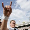 RED RIVER RIVALRY / COTTON BOWL / UT / OU: University of Texas quarterback Colt McCoy (12) flashes a hook \'em horns sign after beating No. 1 University of Oklahoma 45-35 in a NCAA college football game, Saturday, Oct. 11, 2008, in Dallas. (AP Photo/Matt Slocum) ORG XMIT: DNB134