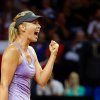 Photo - Russia's Maria Sharapova reacts during her quarterfinal match against Poland's top seed Agnieszka Radwanska at the Porsche tennis Grand Prix in Stuttgart, Germany, Friday, April 25, 2014. Sharapova won the match with 6-4 and 6-3. (AP Photo/dpa,Daniel Maurer)