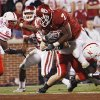 Oklahoma\'s DeMarco Murry (7) fights his way through Nebraska\'s Matt Holt (35) for a touchdown during the first half of the college football game between the University of Oklahoma Sooners (OU) and the University of Nebraska Huskers (NU) at the Gaylord Family-Oklahoma Memorial Stadium, on Saturday, Nov. 1, 2008, in Norman, Okla. BY NATE BILLINGS, THE OKLAHOMAN