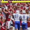 Oklahoma\'s Blake Bell (10) and Gabe Ikard (64) celebrate a touchdown during the college football game between the University of Oklahoma Sooners (OU) and the University of Tulsa Hurricanes (TU) at the Gaylord-Family Oklahoma Memorial Stadium on Saturday, Sept. 14, 2013 in Norman, Okla. Photo by Chris Landsberger, The Oklahoman