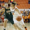 Oklahoma State\'s Liz Donohoe (4) tries to get around Cal Poly\'s Kayla Griffin (1) during the women\'s college basketball game between Oklahoma State and Cal Poly at Gallagher-Iba Arena in Stillwater, Okla., Friday, Nov. 9, 2012. Photo by Sarah Phipps, The Oklahoman