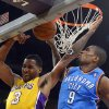 Photo - Oklahoma City Thunder forward Serge Ibaka, of Congo, blocks the shot of Los Angeles Lakers forward Shawne Williams, left, during the first half of an NBA basketball game Thursday, Feb. 13, 2014, in Los Angeles. (AP Photo/Mark J. Terrill)