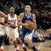 Photo -   Golden State Warriors guard Stephen Curry, right, drives to the basket past Portland Trail Blazers guard Damian Lillard during the first quarter of an NBA preseason basketball game in Portland, Ore., Friday, Oct. 19, 2012. (AP Photo/Don Ryan)