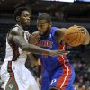 Milwaukee Bucks\' Larry Sanders left, defends as Detroit Pistons\' Greg Monroe drives to the basket during the first half of an NBA basketball game on Saturday, Oct. 13, 2012, in Milwaukee. (AP Photo/Jim Prisching)