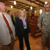 Photo - Gov. Mary Fallin and her husband Wade Christensen are given a tour of the new Thunderbird Chapel by State Chaplain Col. Michael Taylor after its dedication ceremony Saturday at Camp Gruber near Braggs. Photos by James Gibbard, Tulsa World