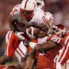 Oklahoma\'s Quinton Carter (20) stops Nebraska\'s Niles Paul (24) during the first half of the college football game between the University of Oklahoma Sooners (OU) and the University of Nebraska Huskers (NU) at the Gaylord Family Memorial Stadium, on Saturday, Nov. 1, 2008, in Norman, Okla. BY STEVE SISNEY, THE OKLAHOMAN