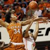 Texas\' Imani McGee-Stafford (34) fouls Oklahoma State\'s Kendra Suttles (31) during a women\'s college basketball game between Oklahoma State University (OSU) and the University of Texas at Gallagher-Iba Arena in Stillwater, Okla., Saturday, March 2, 2013. OSU won, 64-58. Photo by Nate Billings, The Oklahoman