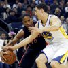 Toronto Raptors\' Demar Derozan, left, drives for the basket as Golden State Warriors\' Klay Thompson defends during the first half of an NBA basketball game in Oakland, Calif., Monday, March 4, 2013. (AP Photo/George Nikitin)
