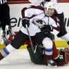 Photo - Colorado Avalanche's Ryan Wilson, left, leaves Minnesota Wild's Dany Heatley on the ice as he skates away after a collision in the first period of an NHL hockey game, Saturday, Jan. 11, 2014, in St. Paul, Minn. (AP Photo/Jim Mone)