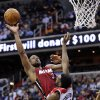 Miami Heat guard Dwyane Wade (3) takes a shot against Washington Wizards forward Chris Singleton (31) during the first half of an NBA basketball game, Tuesday, Dec. 4, 2012, in Washington. (AP Photo/Nick Wass)