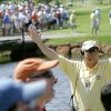 Volunteer Billy Harrison, of Edmond, Okla., holds up his hands to silence crowds as a golfer tees off on No. 9 during the final round of the 67th Senior PGA Championship at Oak Tree Golf Club in Edmond, Okla., Sunday, May 28, 2006. By John Clanton, The Oklahoman