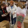 Volunteers Mary DuFran, June Mays, and Carol Schreiner prepare to deliver poinsettias for Meals on Wheels in Norman, Oklahoma on Wednesday, December 5, 2007. Photo By STEVE SISNEY, The Oklahoman