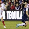 United States\' Abby Wambach deflects a ball in front of China\'s Huang Yini during the second half of an exhibition soccer match, Wednesday, Dec. 12, 2012, in Houston. (AP Photo/David J. Phillip)