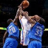 NBA BASKETBALL: Oklahoma City\'s\' Russell Westbrook (0) tries to get between Dallas\' Dominique Jones (20) and Brendan Haywood (33) during a preseason NBA game between the Oklahoma City Thunder and the Dallas Mavericks at Chesapeake Energy Arena in Oklahoma City, Tuesday, Dec. 20, 2011. Photo by Bryan Terry, The Oklahoman