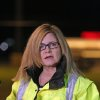 Photo - Sharon Williams, Director of Hanscom Field speaks to the media at the gate of Hanscom Field where a private Gulfstream IV plane with seven people aboard crashed and caught fire late Saturday, May 31, 2014. (AP Photo/The Boston Herald, Stuart Cahill