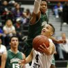 Putnam City\'s David Bush goes past Edmond Santa Fe\'s Aaron Anderson during a high school basketball game at Putnam City in Oklahoma City, Tuesday, Feb. 7, 2012. Photo by Bryan Terry, The Oklahoman