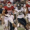 Oklahoma\'s Trey Millard (33) runs past Missouri\'s Zavier Gooden (25) during the college football game between the University of Oklahoma Sooners (OU) and the University of Missouri Tigers (MU) at the Gaylord Family-Memorial Stadium on Saturday, Sept. 24, 2011, in Norman, Okla. Photo by Chris Landsberger, The Oklahoman