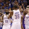 Oklahoma City\'s James Harden (13) and Kevin Durant (35) slap hands beside Los Angeles\' Kobe Bryant (24) during Game 1 in the second round of the NBA playoffs between the Oklahoma City Thunder and L.A. Lakers at Chesapeake Energy Arena in Oklahoma City, Monday, May 14, 2012. Photo by Bryan Terry, The Oklahoman
