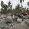 A resident looks at the devastation brought about by the flash flood that hit the village of Andap, New Bataan township, Compostela Valley in southern Philippines Wednesday Dec. 5, 2012. Typhoon Bopha, one of the strongest typhoons to hit the Philippines this year, barreled across the country\'s south on Tuesday, killing scores of people while triggering landslides, flooding and cutting off power in two entire provinces. (AP Photo/Bullit Marquez)