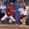 Oklahoma\'s Brianna Turang (2) runs into first past Alabama\'s Cassie Reilly-Boccia (18) during a Women\'s College World Series softball game between OU and Alabama at ASA Hall of Fame Stadium in Oklahoma City, Tuesday, June 5, 2012. Photo by Garett Fisbeck, The Oklahoman