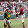 OU\'s Erik Ross (6) reacts after scoring the winning run near Baylor catcher Josh Ludy (30) in the bottom of the ninth inning during a Big 12 Baseball Championship tournament game between the Oklahoma Sooners and Baylor Bears at the Chickasaw Bricktown Ballpark in Oklahoma City,Thursday, May 24, 2012. OU won, 3-2. Photo by Nate Billings, The Oklahoman