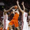 Oklahoma State\'s Keiton Page (12) tries to go between Oklahoma\'s Steven Pledger (2) and Tyler Neal (15) during the Bedlam men\'s college basketball game between the University of Oklahoma Sooners and the Oklahoma State Cowboys in Norman, Okla., Wednesday, Feb. 22, 2012. Oklahoma won 77-64. Photo by Bryan Terry, The Oklahoman