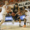 West Virginia\'s Deniz Kilicli (13) drives between Oklahoma State\'s Philip Jurick (44), left, and Marcus Smart (33) during an NCAA men\'s basketball game between Oklahoma State University (OSU) and West Virginia at Gallagher-Iba Arena in Stillwater, Okla., Saturday, Jan. 26, 2013. Photo by Nate Billings, The Oklahoman