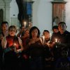 People hold candles during a vigil in support of Venezuela\'s President Hugo Chavez in Caracas, Venezuela, Thursday, Dec. 13, 2012. Chavez is recovering favorably despite suffering complications during cancer surgery in Cuba, his vice president Nicolas Maduro said Thursday amid uncertainty over the Venezuelan leader\'s health crisis and the country\'s political future. (AP Photo/Fernando Llano)