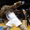 Thunder mascot Rumble the Bison throws t-shirts to the crowd during an NBA basketball game between the New York Knicks and the Oklahoma City Thunder at Chesapeake Energy Arena in Oklahoma City, Sunday, Feb. 9, 2014. Oklahoma City won, 112-100. Photo by Nate Billings, The Oklahoman